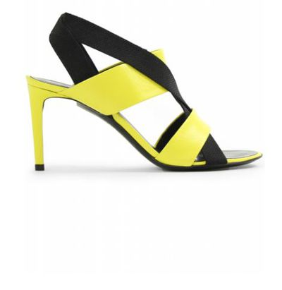 "Open-toe sandal, Balenciaga, $365 at <a href=""https://www.parlourx.com/balenciaga-open-toe-leather-heels-black-acid-yellow.html"" target=""_blank"">Parlour X</a><br />"
