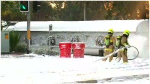 HAZMAT crews used foam to smother fuel after a truck overturned yesterday morning. (9NEWS)