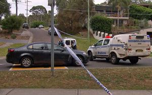 Man arrested after woman's body found in Sydney driveway