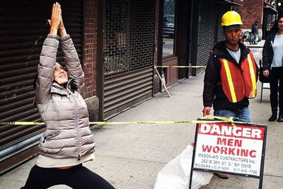 Danger? Men working? Hilaria's too busy saluting the sun to care.
