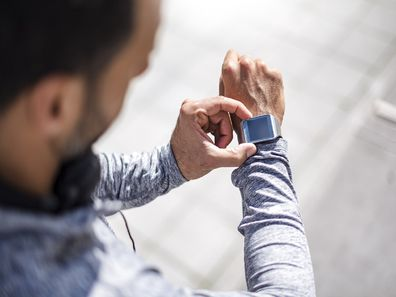 Man checking his Apple Watch
