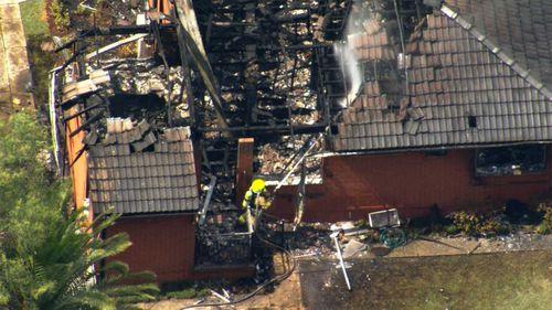 Two dozen firefighters worked to extinguish the Baulkham Hills blaze.
