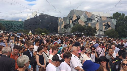 Thousands gathered at Federation Square to pay tribute to the Bourke Street Mall victims. (9NEWS)