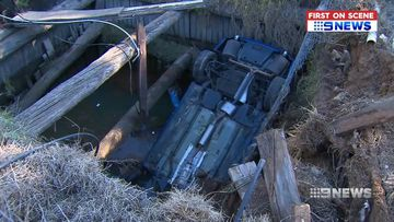 Car crashes five metres into dam during police chase