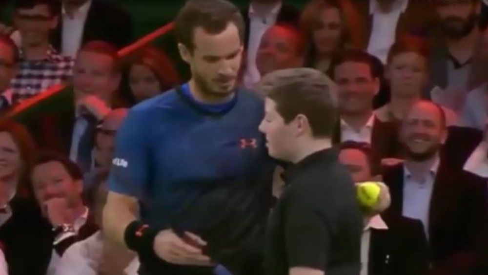 Britain's Andy Murray lets ball boy take match point against Roger Federer