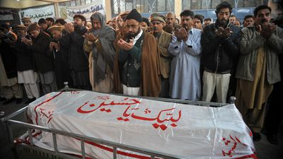 Pakistani mourners pray over the coffin of a student killed in the attack. (Getty Images) <br> <br> Authorities believe the death toll stands at 141, most of them children from an Army-run school.