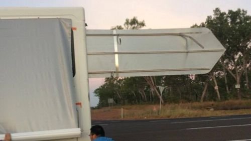 "The ""Katherine to Darwin"" sign pierced through the cabin of the van. (9NEWS)"
