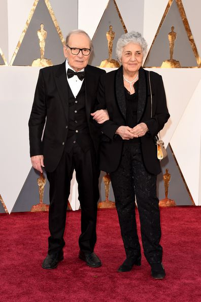 talian composer Ennio Morricone and his wife Maria Travia attend the 88th Annual Academy Awards at Hollywood & Highland Center on February 28, 2016 in Hollywood, California.