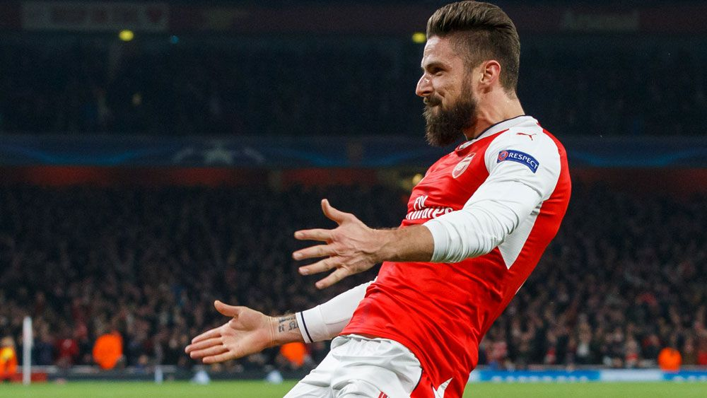 Olivier Giroud celebrates after scoring in Arsenal's Champions League match. (AAP)
