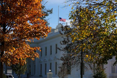The American flag flies at half staff over the White House following the shooting.