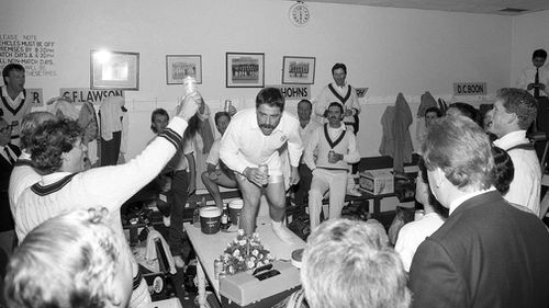 Australian player David Boon leads the team in a rendition of the team song 'Under the Southern Cross' in 1989. (Philip Brown, Popperfoto, Getty Images)