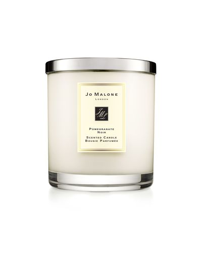 """<a href=""""https://www.jomalone.com.au/product/2833/10082/for-the-home/candles/home-candle/pomegranate-noir-home-candle"""" target=""""_blank"""" draggable=""""false"""">Jo Malone Pomegranate Noir Home Candle 200G, $88</a>"""