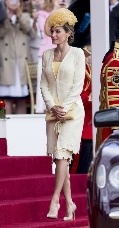 Queen Letizia was a ray of sunshine as she kicked off the British tour in a yellow ensemble by her favourite Spanish designer Felipe Varela. In keeping with British royal protocol the Spanish also wore a hat and gloves-the former being from designer María Nieto.