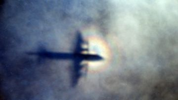 The shadow of a Royal New Zealand Air Force P3 Orion is seen on low level cloud while the aircraft searches for missing Malaysia Airlines Flight MH370. Picture: AP