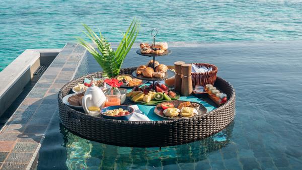 Floating breakfast tray in luxury resort, in a Maldives overwater bungalow
