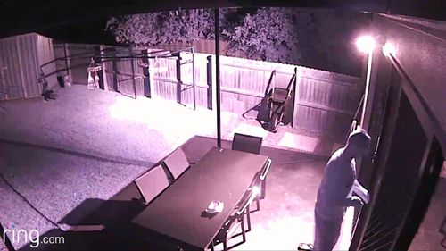 An intruder in Dundas tries to break in a door.