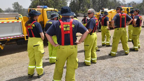 Rural firefighters are seen preparing to fight fires at Spicers Gap, south west of Brisbane, Wednesday, November 13, 2019.