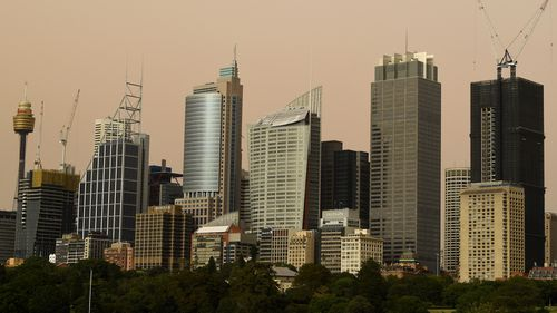 Sydney's skyline was partially obscured by dust this morning.