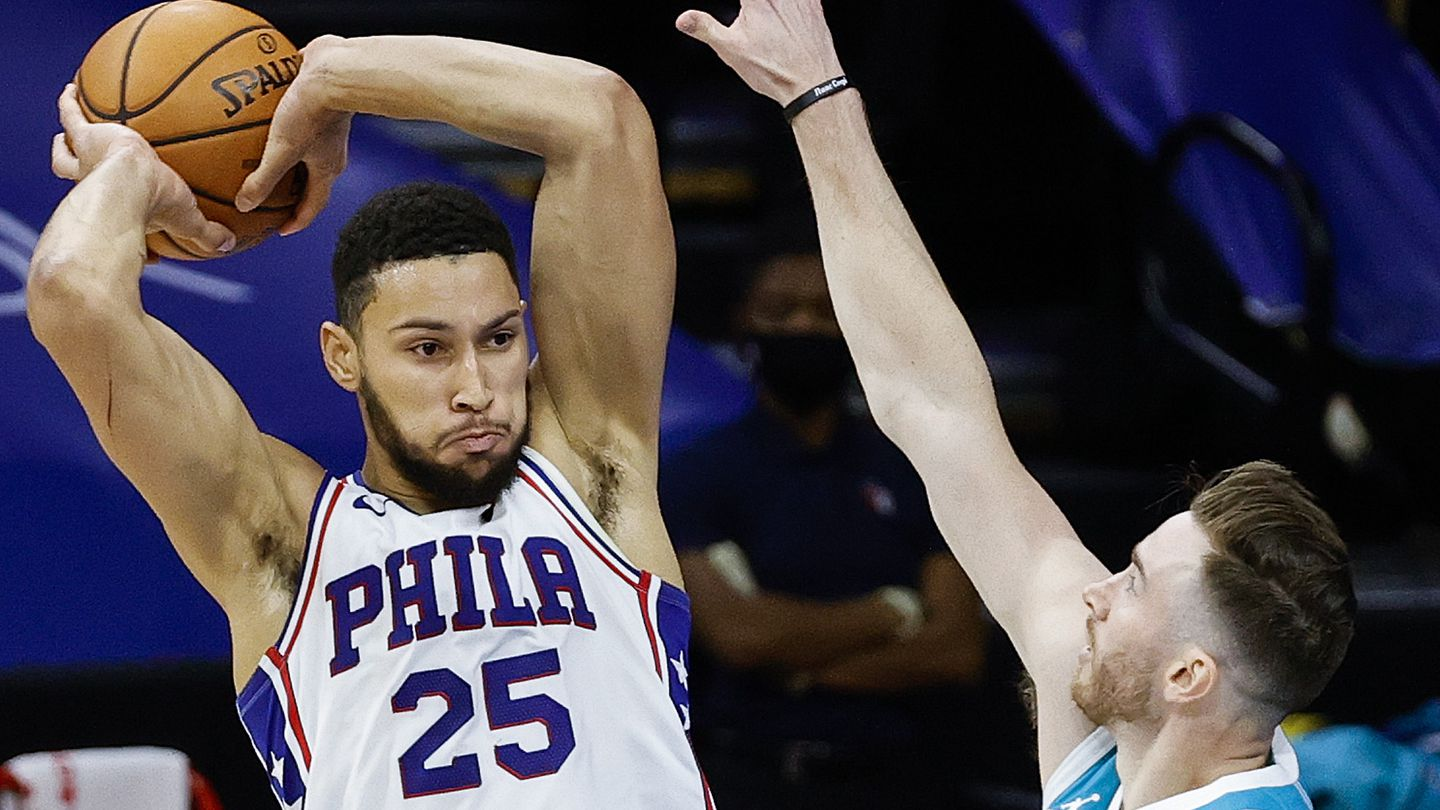 Ben Simmons of the Philadelphia 76ers passes over Gordon Hayward of the Charlotte Hornets.
