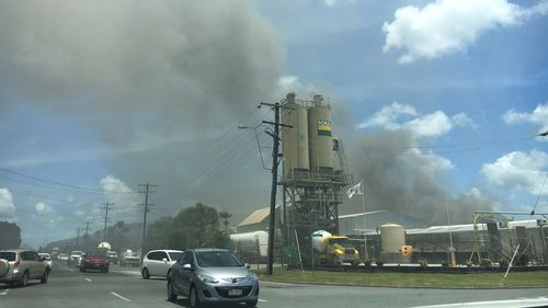 Plumes of smoke are seen billowing across Cairns. (9NEWS)