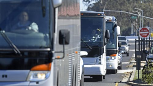 Three buses leave Travis Air Force Base carrying passengers that were aboard the Diamond Princess cruise ship.