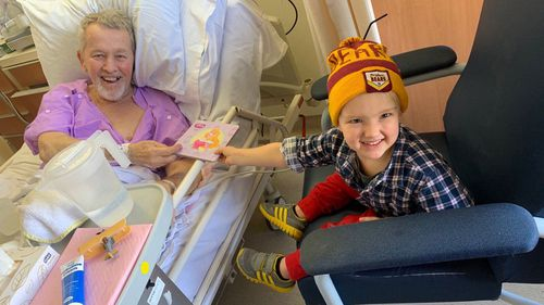 Josh Adams's father (left) and his young son at a time when family could make a joint hospital visit.
