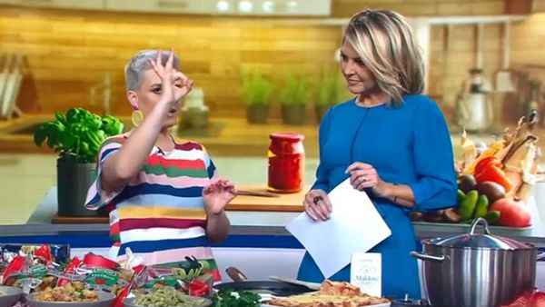 Food presenter Jane de Graaff demonstrates long thin pasta measuring with Georgie Gardner