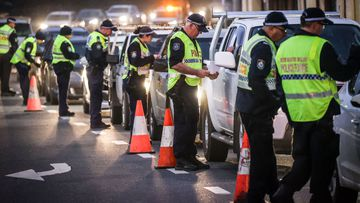 Police at checkpoint in Albury on the NSW-Victoria border on July 8.