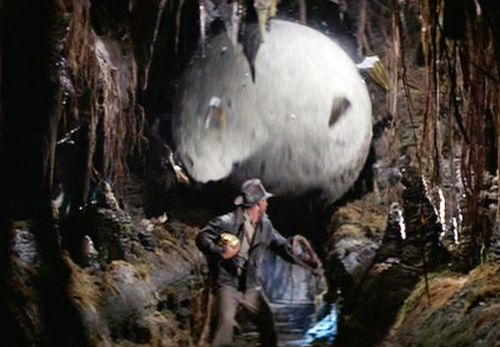 Harrison Ford in Indiana Jones: Raiders of the Lost Ark being chased by a giant boulder.