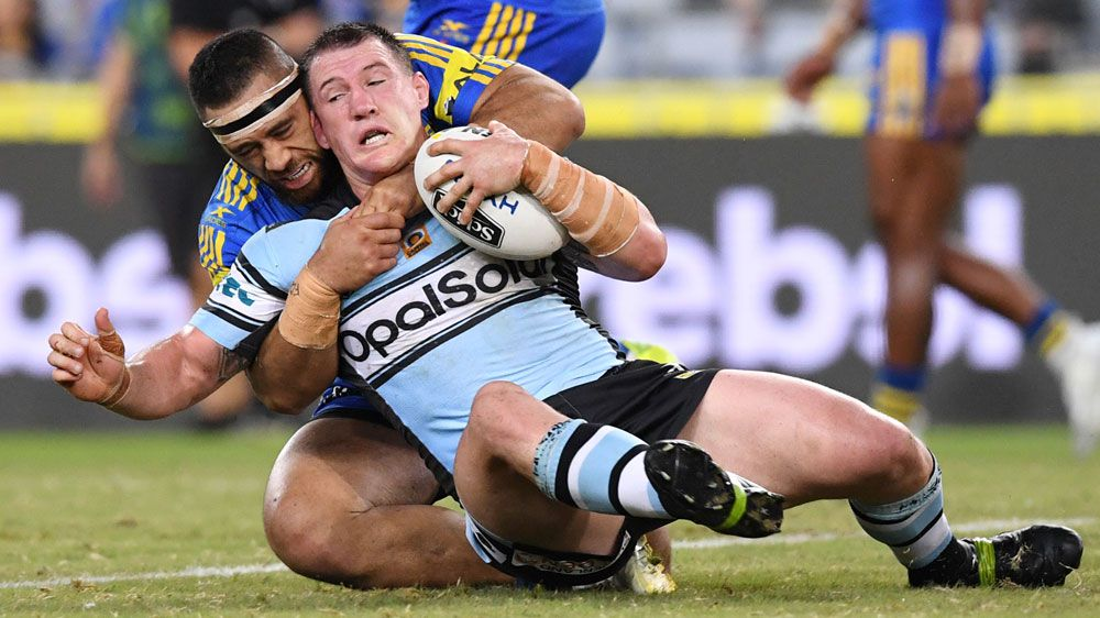The Sharks' Paul Gallen wrestles with Susaia Matagi.