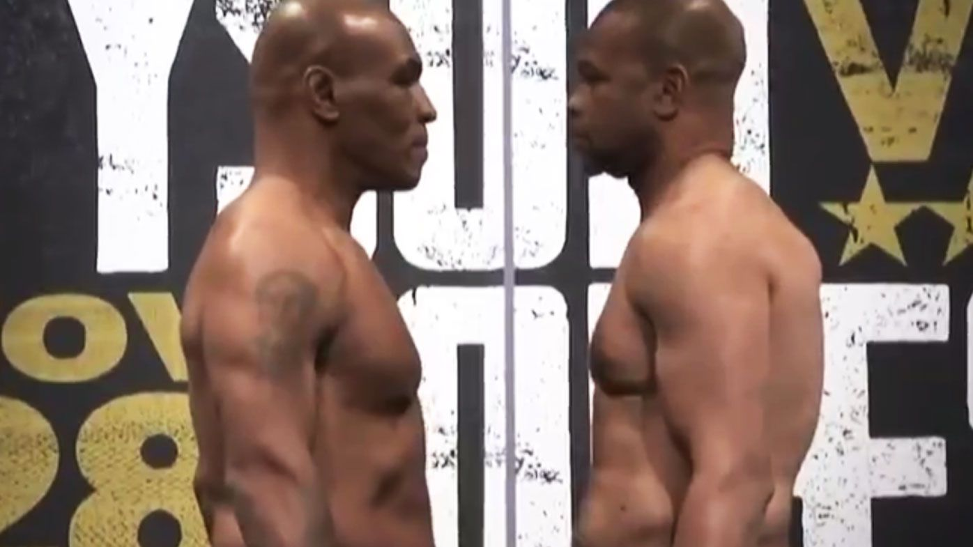 Mike Tyson and Roy Jones Jr face-off.