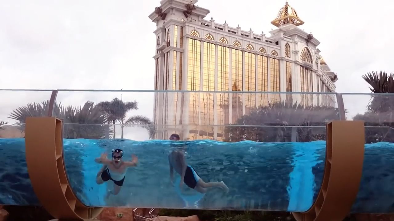 Float along transparent glass tubes at this Macau hotel