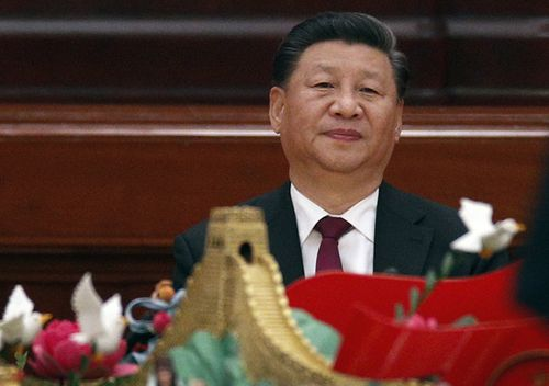 Chinese President Xi Jinping arrives at a dinner marking the 70th anniversary of the founding of the People's Republic of China at the Great Hall of the People in Beijing. Xi renewed his government's commitment to allowing Hong Kong to manage its own affairs amid continuing anti-government protests in the semi-autonomous Chinese territory.