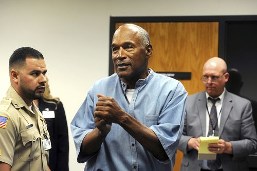 The former NFL football star O.J. Simpson reacts after learning he was granted parole during a hearing at the Lovelock Correctional Center in July. (AP)
