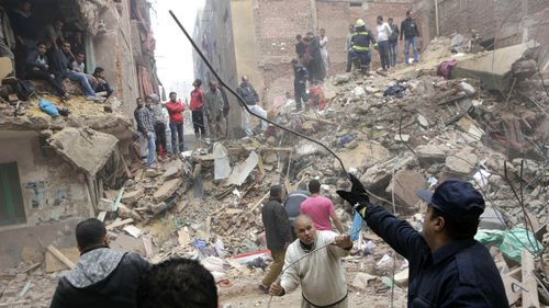 At least 17 dead after 'illegally built' building collapses in Cairo