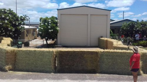 Hay bales were also used to create the makeshift enclosure. (Queensland Police)