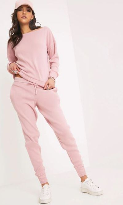 "<a href=""https://www.prettylittlething.com.au/auriel-pink-jogger-jumper-knitted-lounge-set.html?utm_source=google&amp;utm_medium=cpc&amp;utm_campaign=google_shopping_aus&amp;utm_content=aus&amp;utm_term=product_target&amp;istCompanyId=74121939-b5b6-4d8b-9339-c063e6f96600&amp;istItemId=xpxmmtaiwp&amp;istBid=tzxi&amp;gclid=EAIaIQobChMI7_ncpO2h2QIVyAgqCh1QSQQVEAkYBiABEgKL9PD_BwE"" target=""_blank"" draggable=""false"">Auriel pink jogger lounge set</a>, $60"