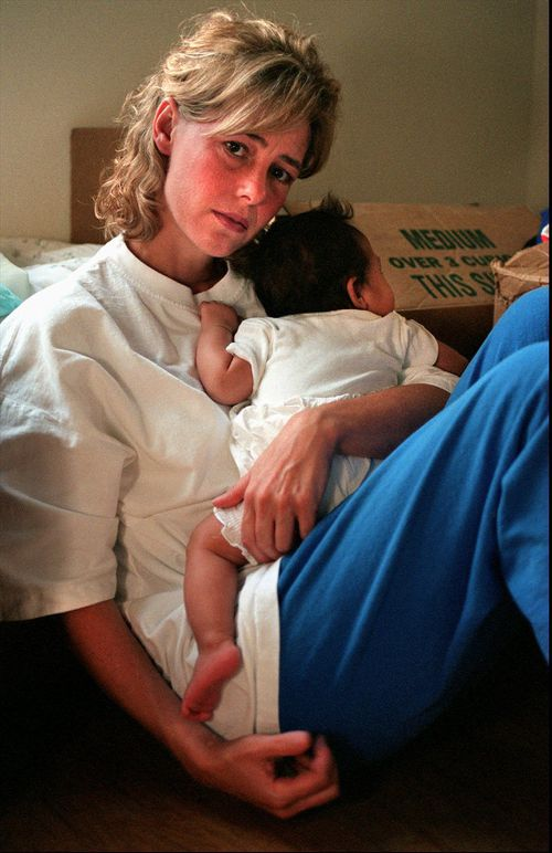 Mary Kay LeTourneau holds the baby in Normandy Park. Picture: AAP