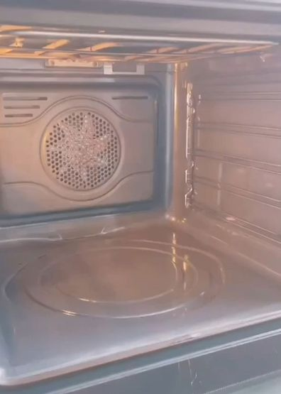 Woman shares TikTok hack for cleaning oven while you sleep.