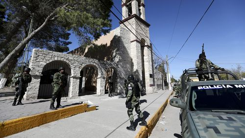 National Guard soldiers take position before the arrival of Coahuila Governor Miguel Riquelme.