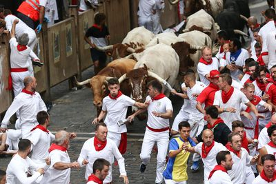 Bulls of the Puerto de San Lorenzo bull ranch run down a street during the traditional San Fermin bull run in Pamplona, Spain
