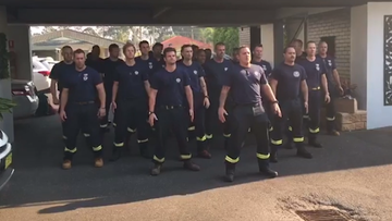 Firefighters from New Zealand perform the Haka before returning home