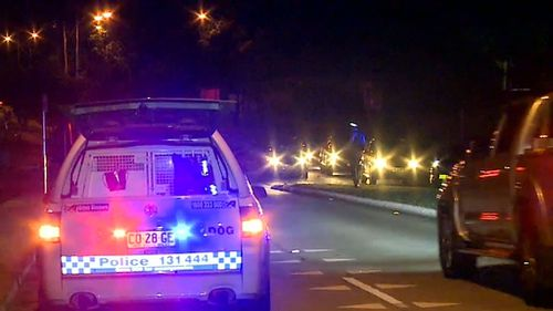 The officer stopped his vehicle on Luxford Road after he saw two men fighting. (9NEWS)