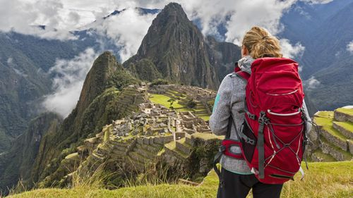 Woman backpacking alone travel