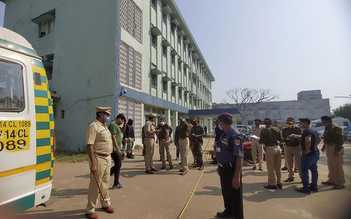 Police officers investigate the scene after a fire broke out at District General Hospital in Bhandara, about 70 kilometres from Nagpur, India, Saturday, Jan. 9, 2021.