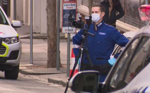 Forensic police photograph the crime scene. Picture: 9NEWS