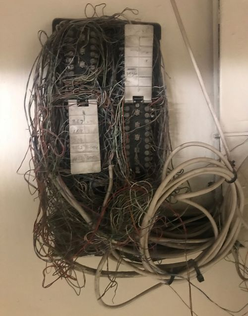 Phone lines are twisted around themselves so it's hard to tell where they are going. Picture: Gabrielle Adams