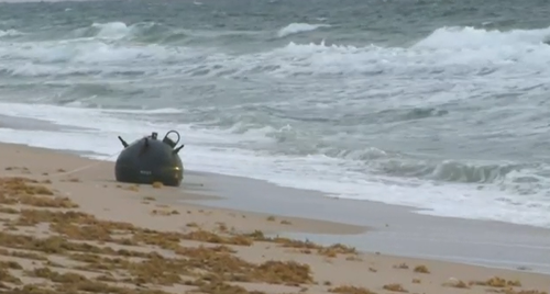 A portion of the beach had to be closed as the bomb squad and X worked to remove the device.