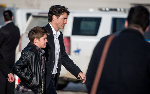 Justin Trudeau arrives at the vigil with his 11-year-old son Xavier. (AAP)