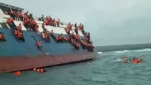 Video shows the passengers clinging to the vessel as it goes under. Picture: AP